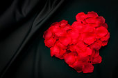 Heart shaped red rose petals for Valentines with copyspace