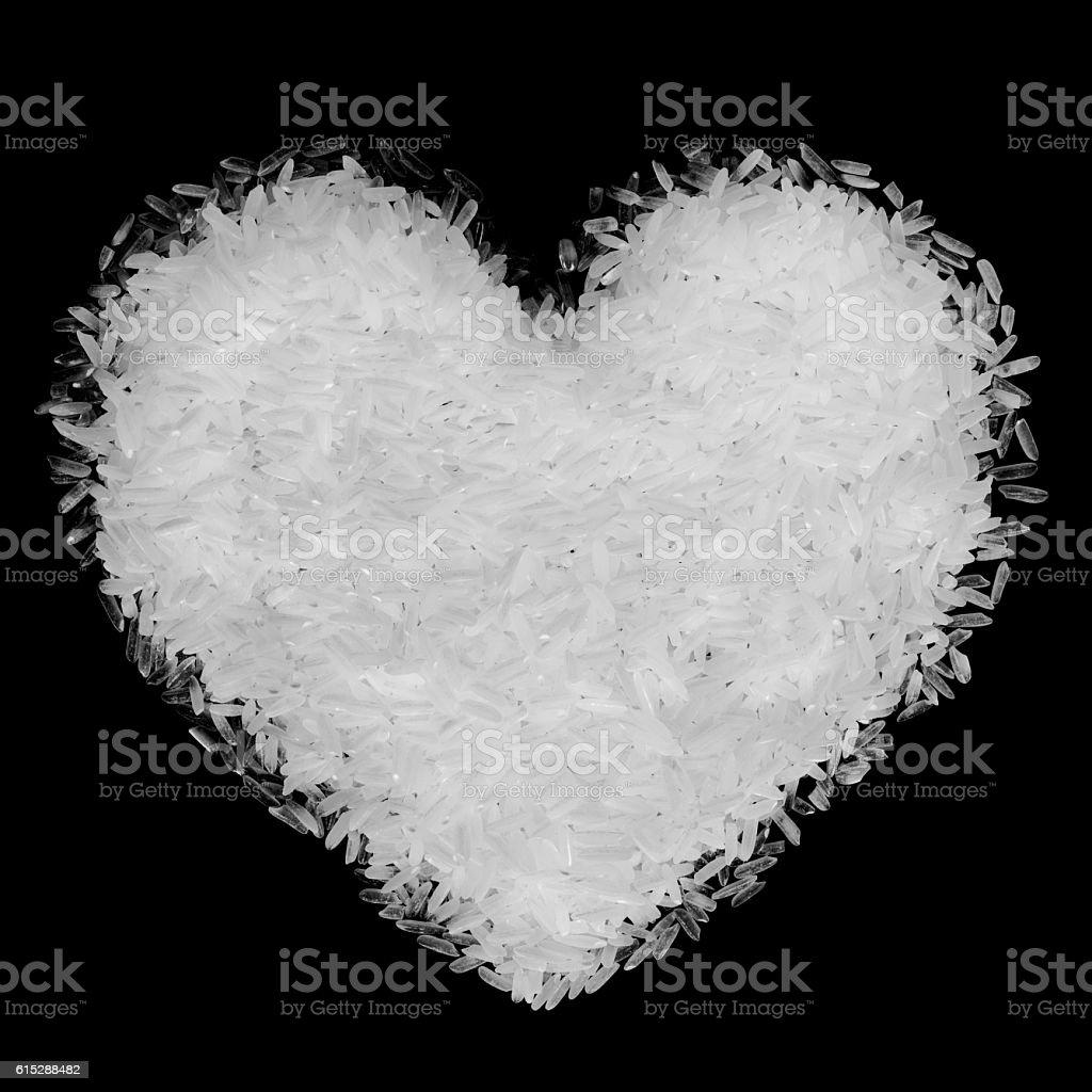 Heart shaped Rice heap isolated black stock photo