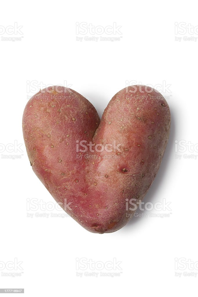 Heart shaped Roseval potato stock photo