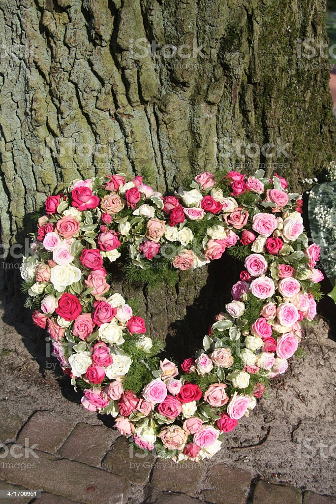 Heart shaped sympathy floral arrangement royalty-free stock photo