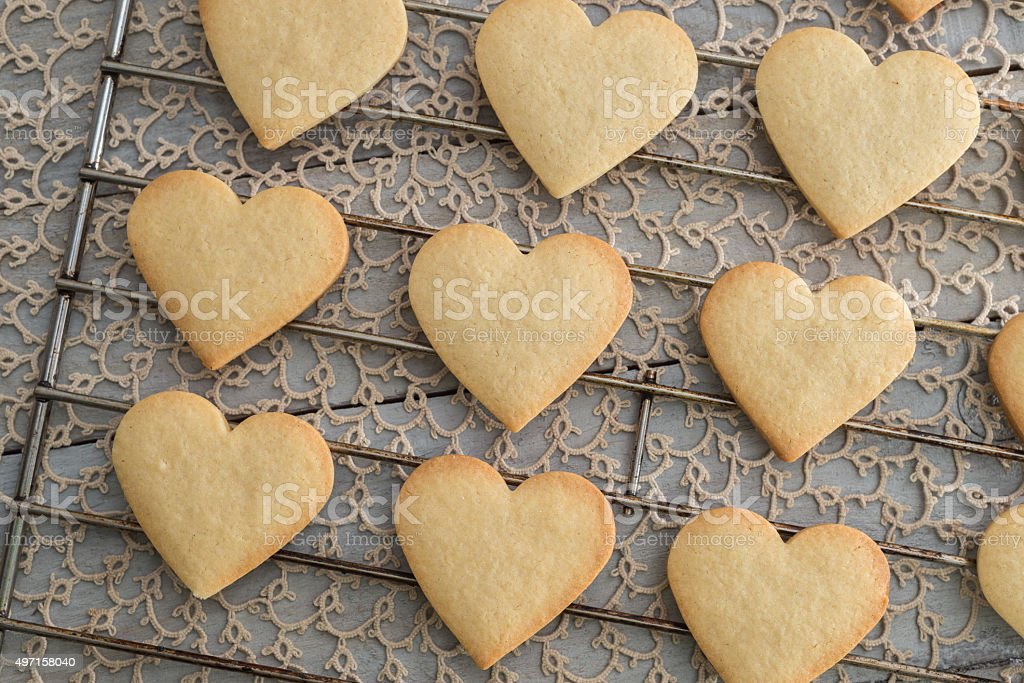Heart shaped valentine's butter cookies cooling on the rack stock photo