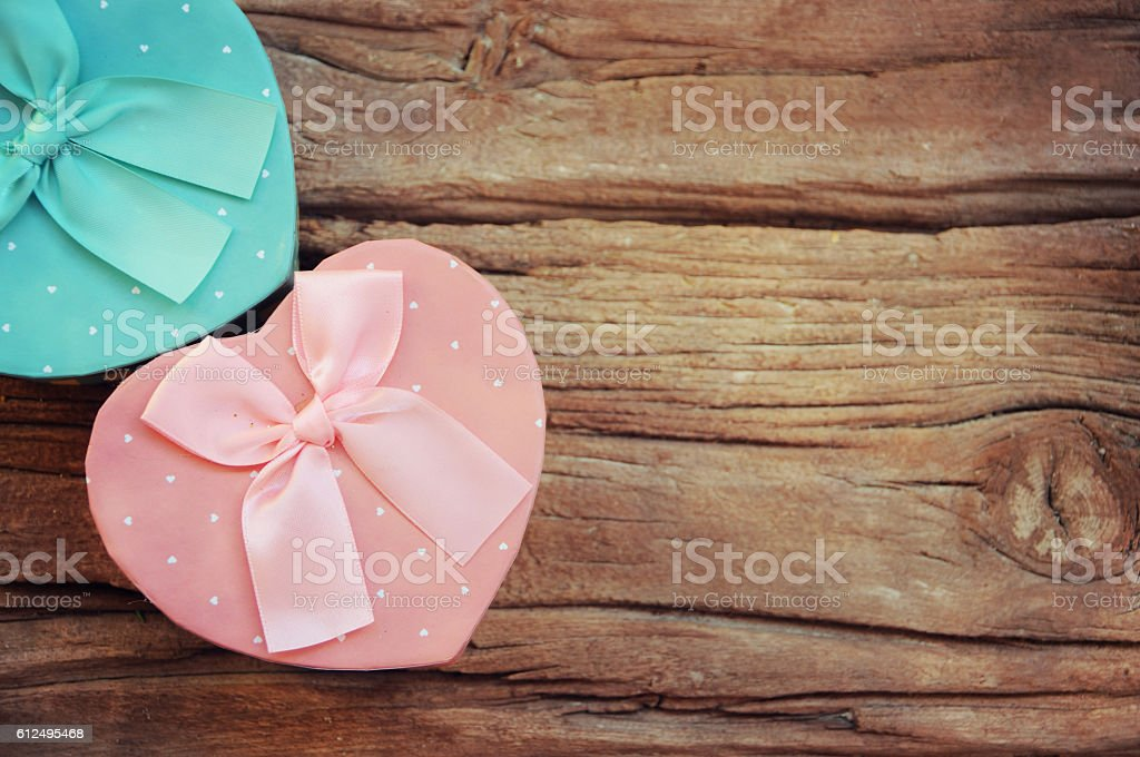 Heart shaped Valentines Day gift box on the wooden board, stock photo