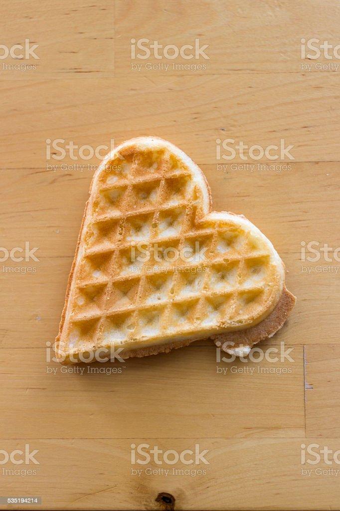 Heart shaped waffle on wood table stock photo