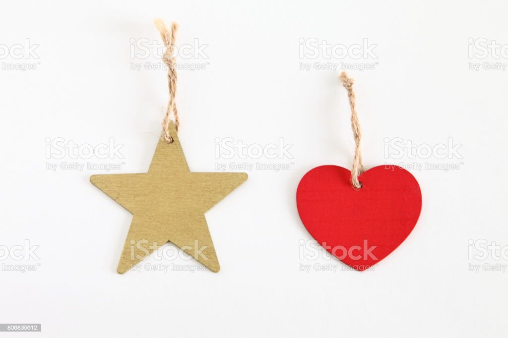 Heart & star shaped tag with rope isolated on white stock photo