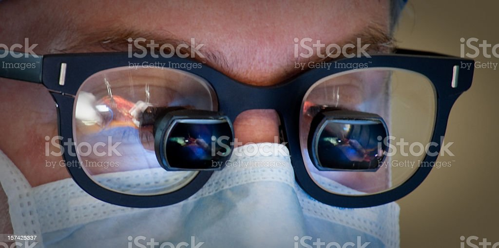Heart Surgeon's Face with Loupes Close Up stock photo