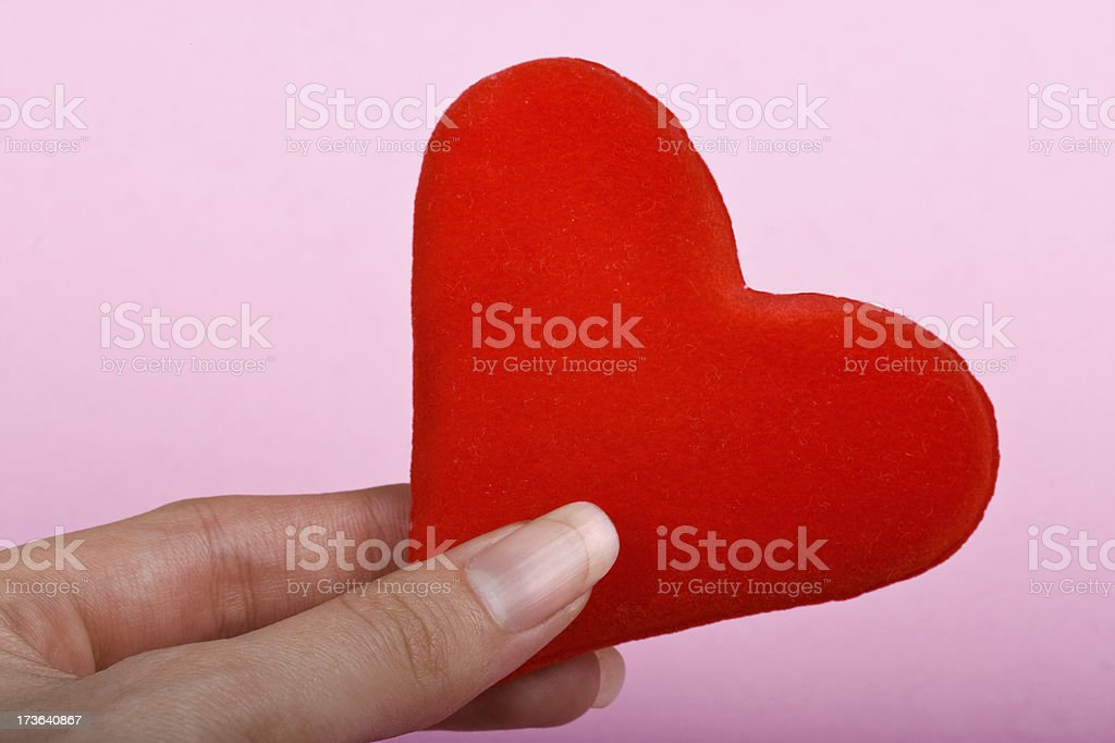 heart symbol in hand stock photo