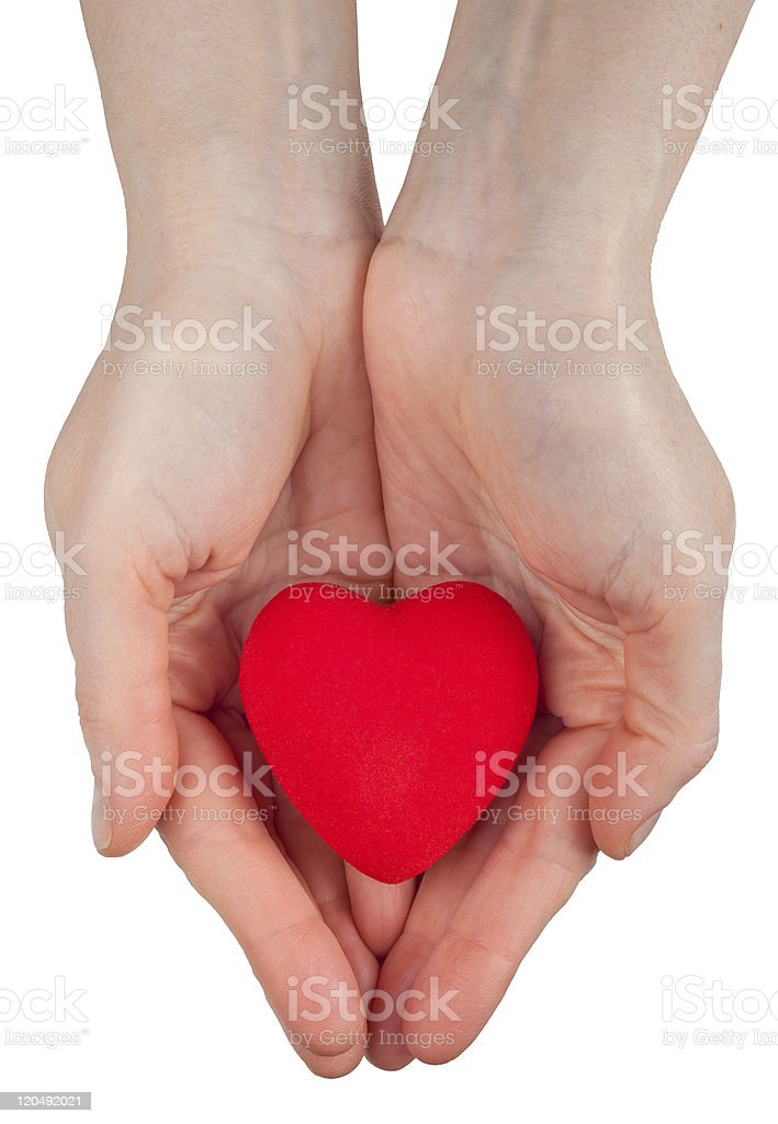 Heart symbol in hands royalty-free stock photo