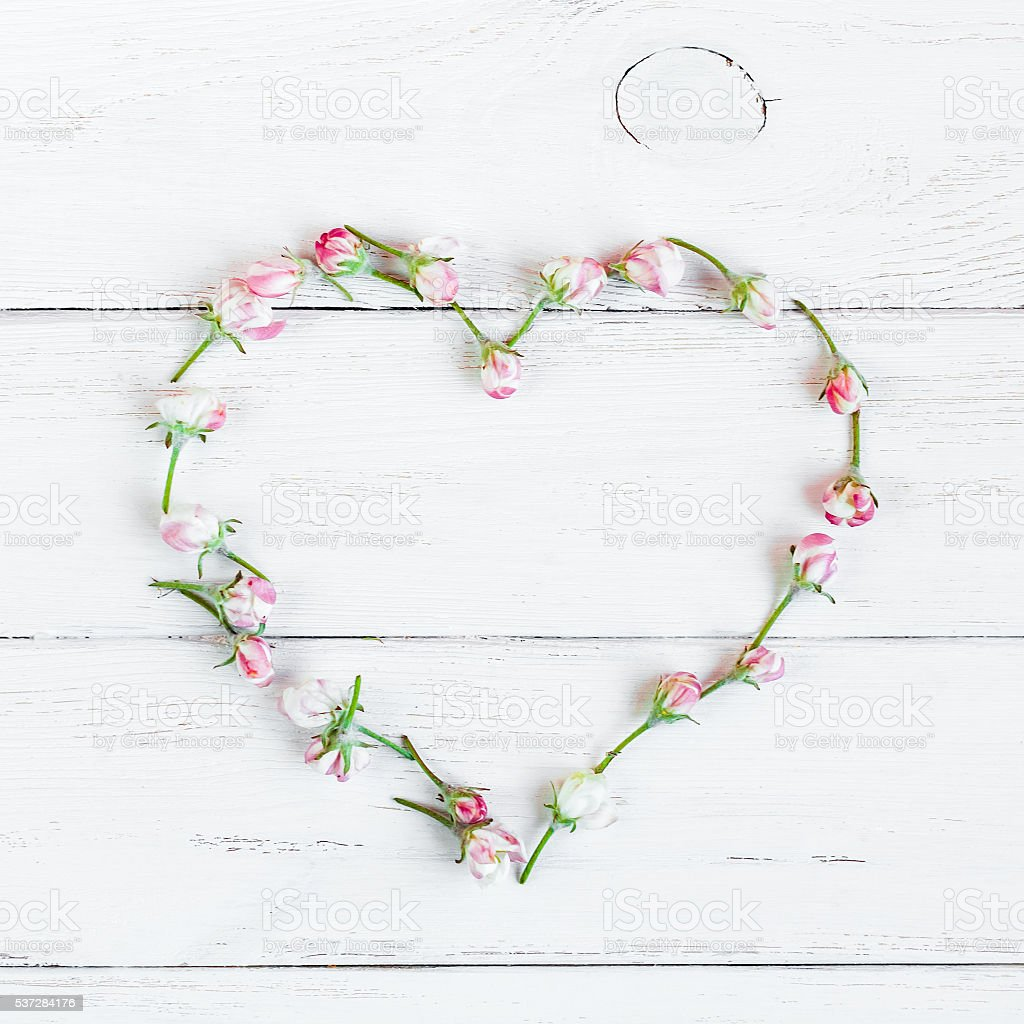 Heart symbol made of flowers stock photo