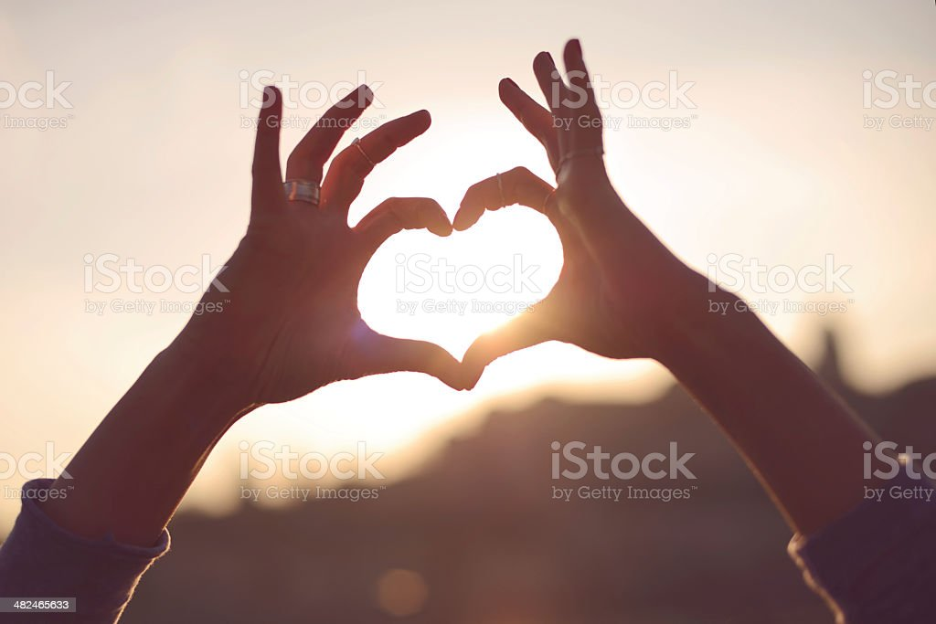 Heart symbol made with hands. stock photo