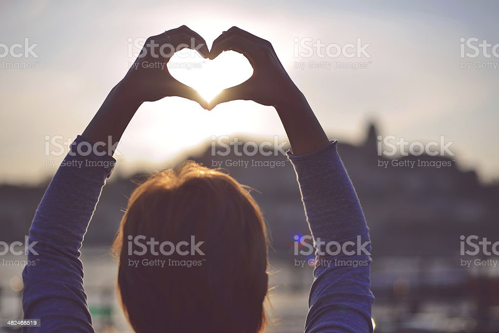 Heart symbol made with hands stock photo