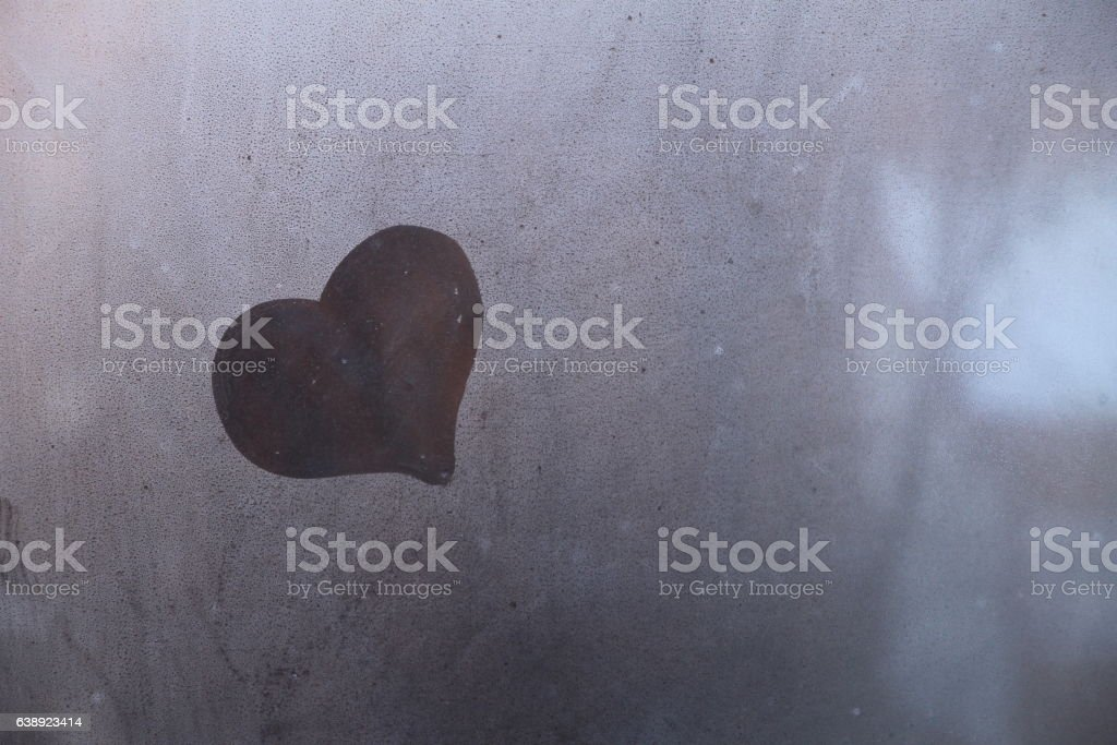 Heart symbol of love drown on the glass stock photo
