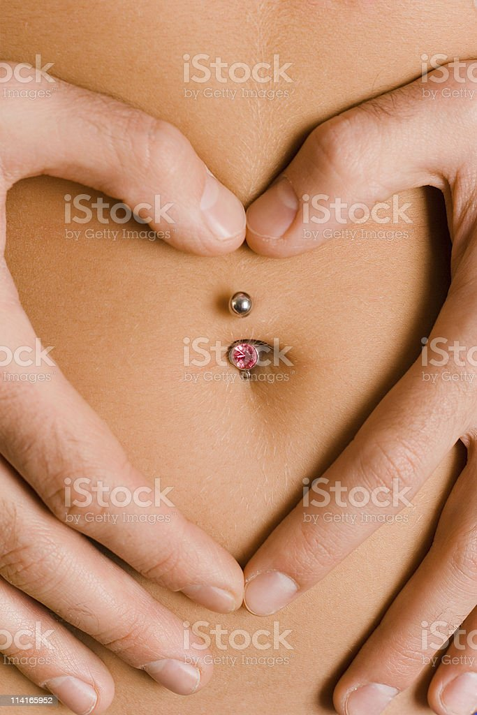 heart symbol on woman's belly royalty-free stock photo