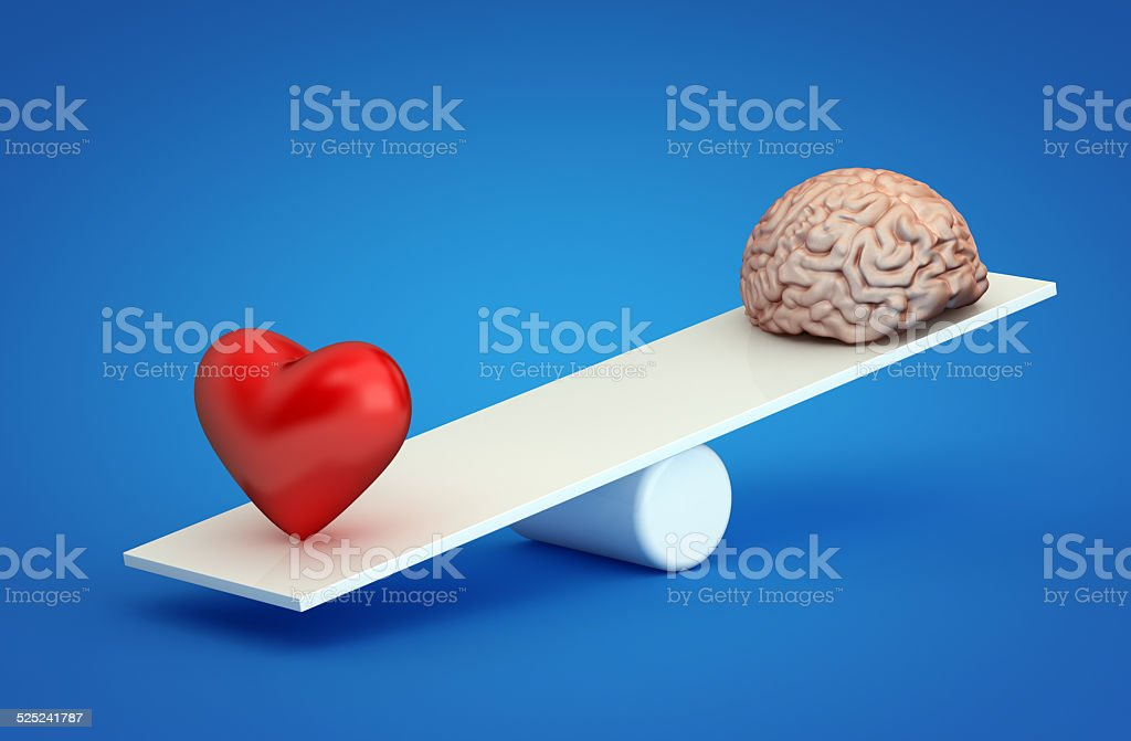 Heart vs brain stock photo