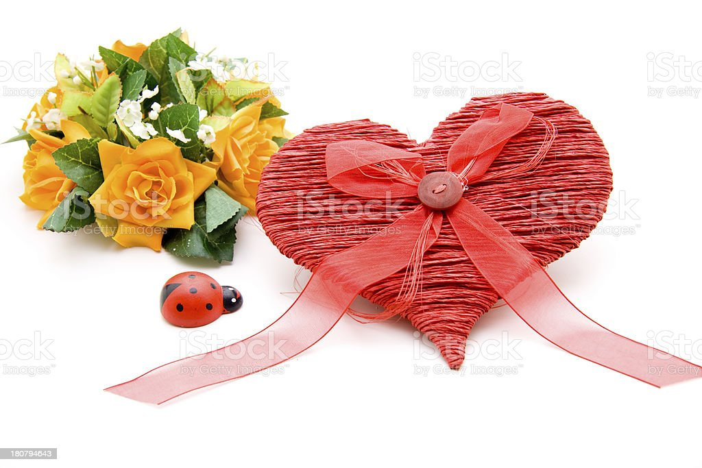 Heart with button in loop and ladybug stock photo