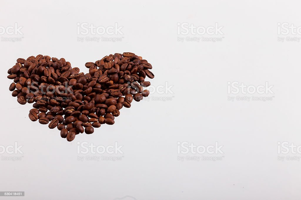 Heart with roasted coffee beans stock photo