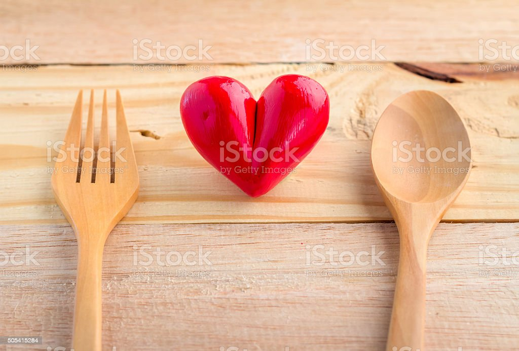 heart with wooden spoon and fork good food concept stock photo