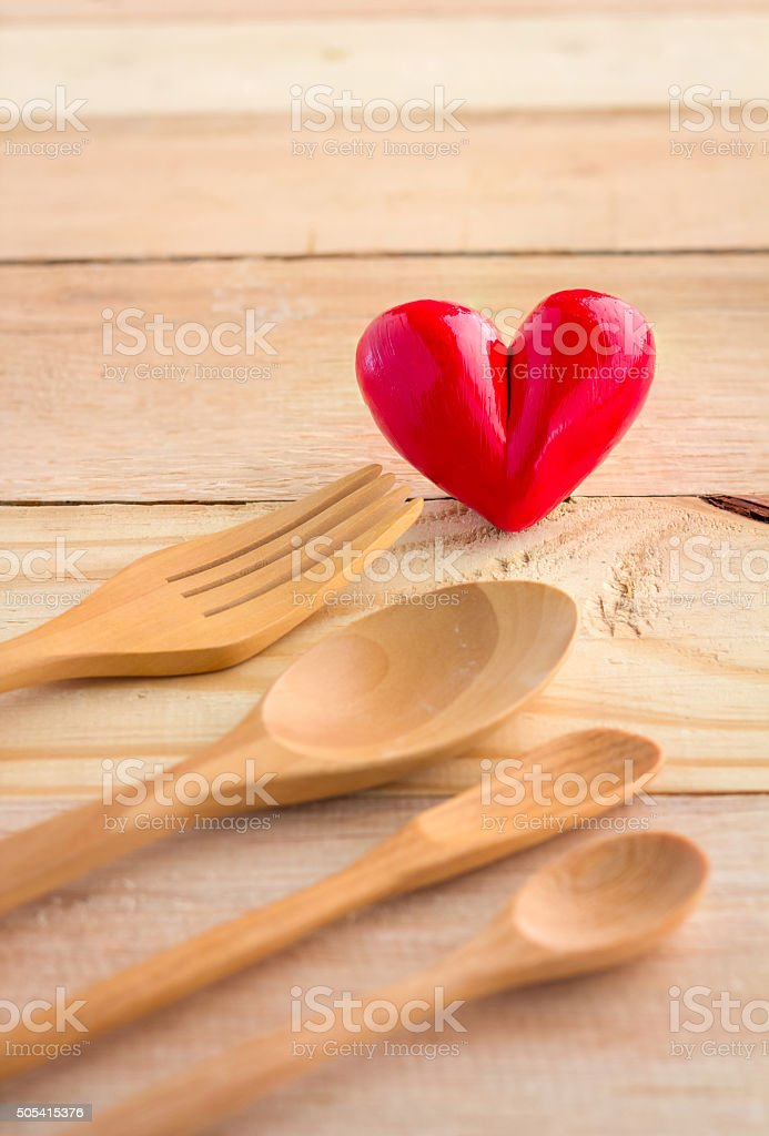 heart with wooden spoon and fork stock photo
