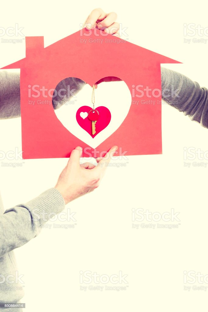 Heart within house. stock photo