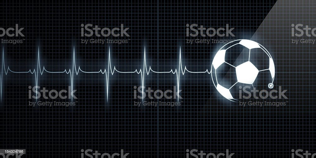 Heartbeat Monitor with soccer ball stock photo