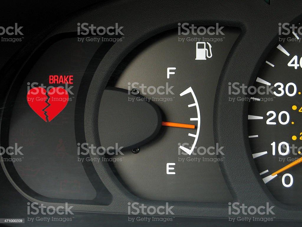 Heartbreak Concept: Car Instrument Panel with Broken Heart Warning royalty-free stock photo