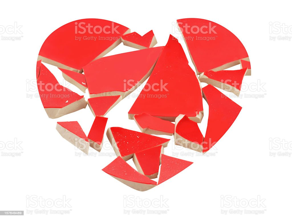 Heartbreak concept with broken heart isolated on white. stock photo