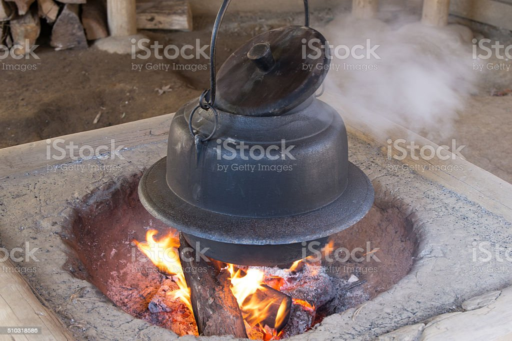 Hearth end of kettle to boil water stock photo