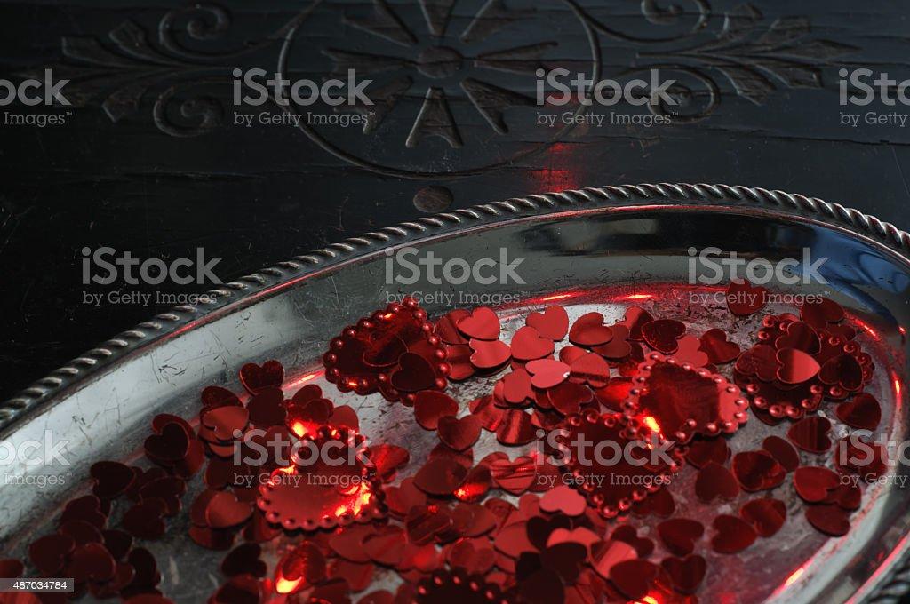 Hearts Confetti on Silver Tray Stock Photo stock photo
