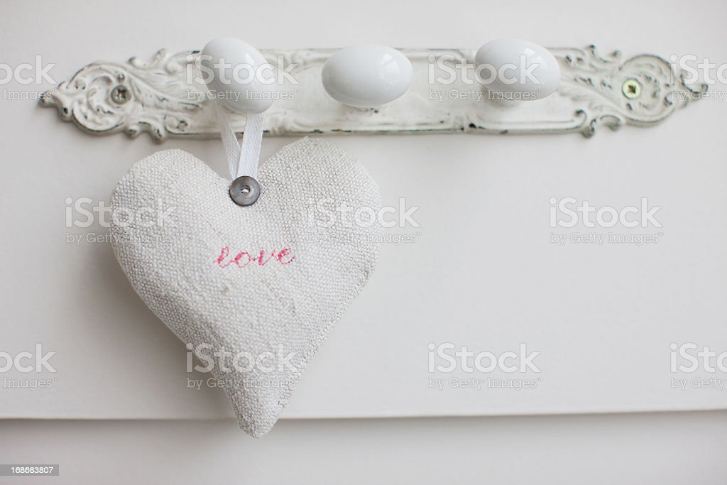Hearts hanging on wall royalty-free stock photo