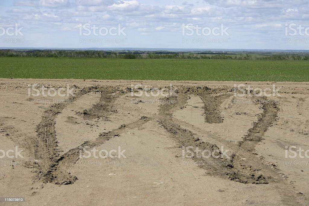 Hearts in the mud - made by tires royalty-free stock photo