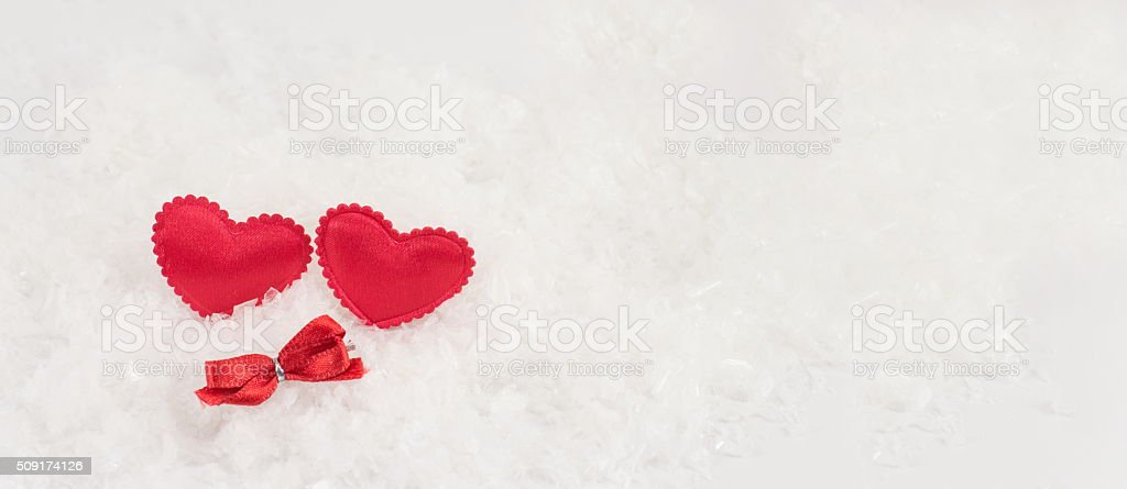 hearts on a white snowy background stock photo