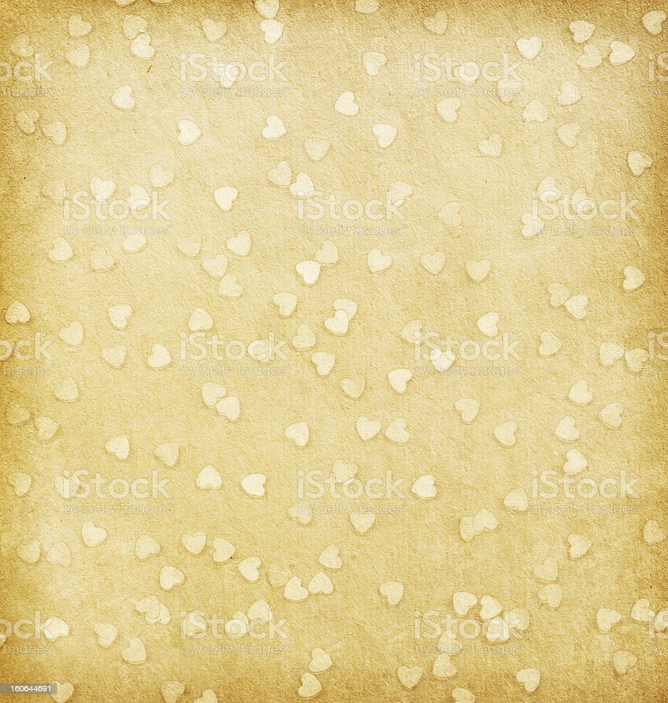 Hearts on  beige paper. royalty-free stock photo