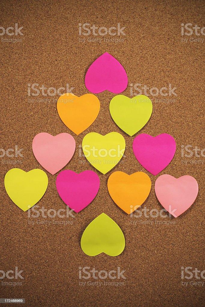 Hearts on corkboard royalty-free stock photo