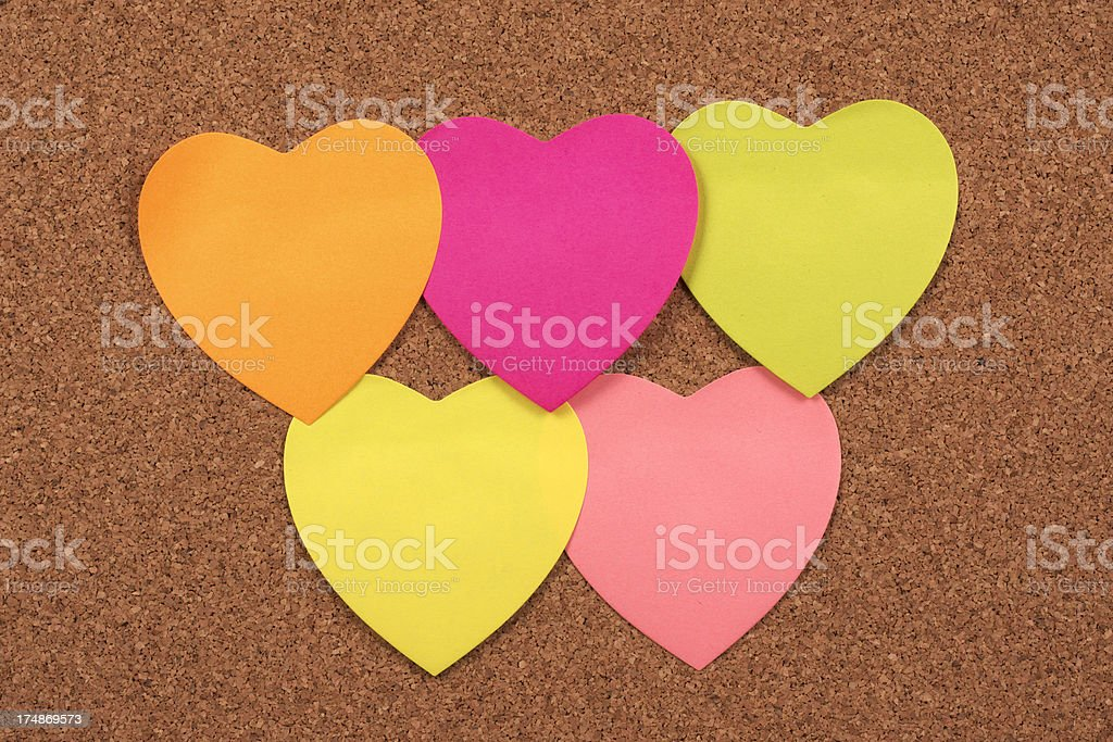 Hearts on corkboard royalty-free stock photo