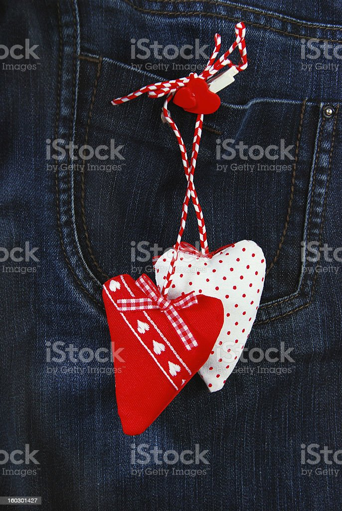 hearts on denim background royalty-free stock photo