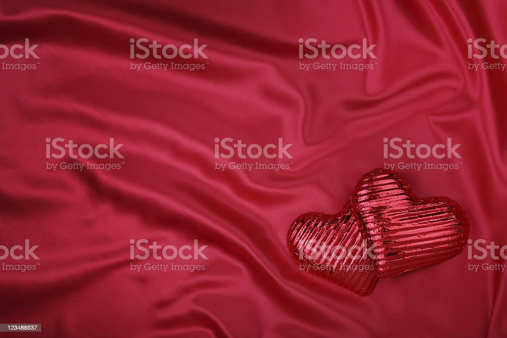 hearts on satin background stock photo