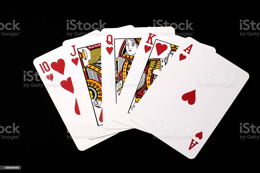 Hearts royal flush hand isolated on black stock photo