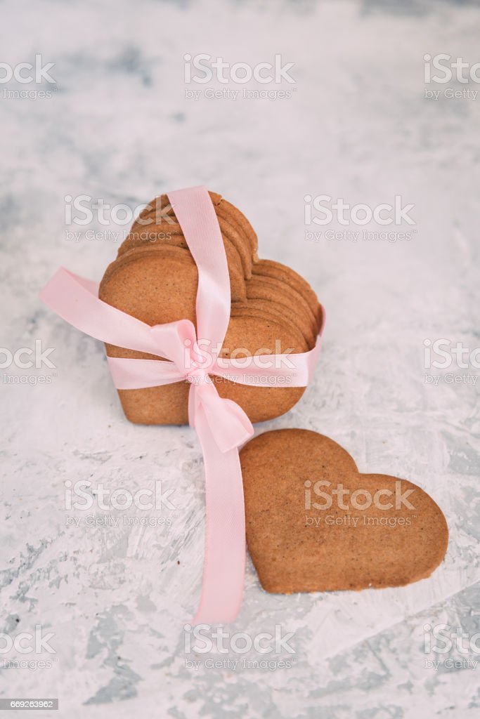Hearts shaped cookies over vintage background. Close up stock photo