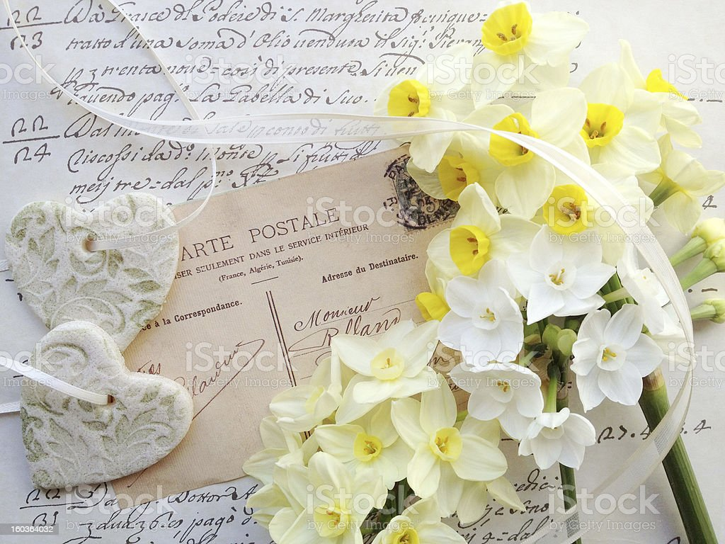 hearts, spring flowers on old postcard royalty-free stock photo