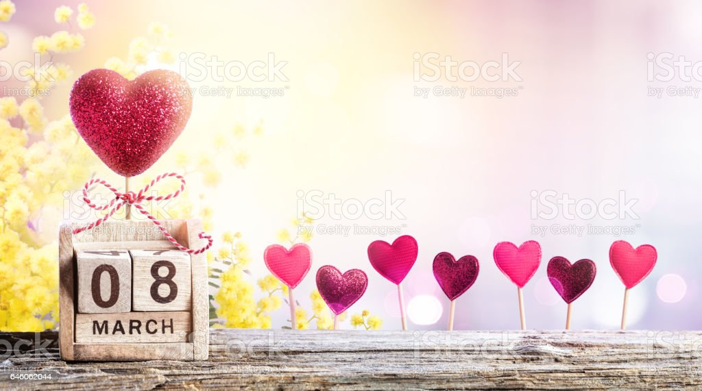 8 Hearts With Mimosa And Calendar For Women Day Background stock photo