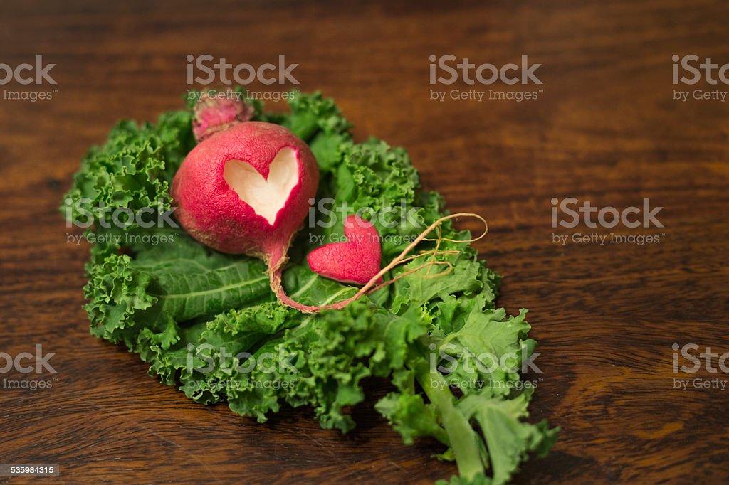 Heart-shape cut out on turnip stock photo