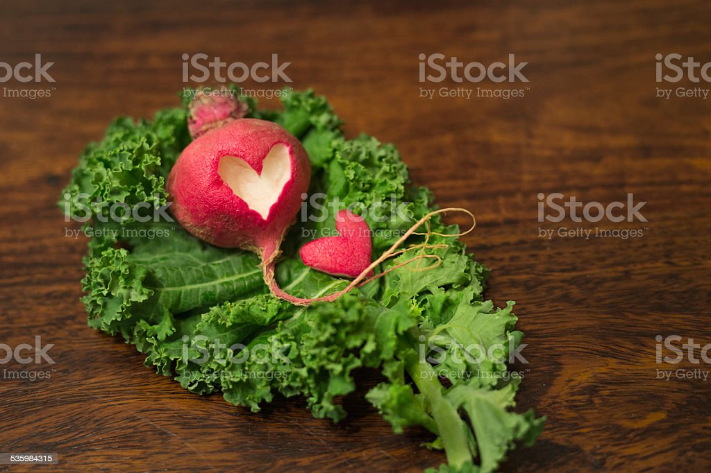 Heart-shape cut out on turnip stock photo