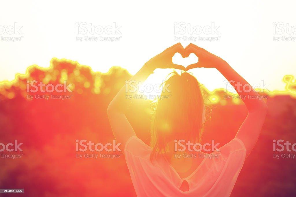Heart-shape for the sun. stock photo