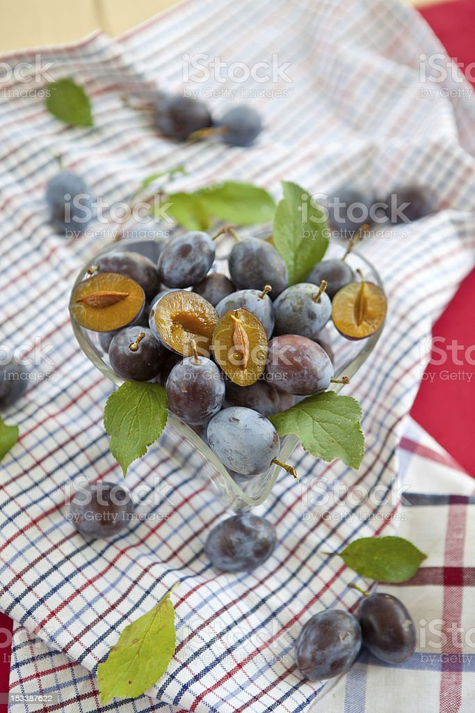 Heart-shaped bowl with plums stock photo
