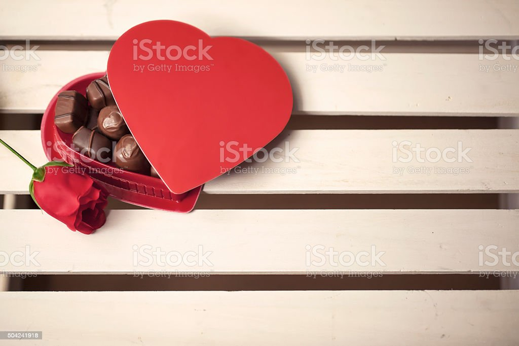 Heart-Shaped Box of Chocolates and a Rose stock photo