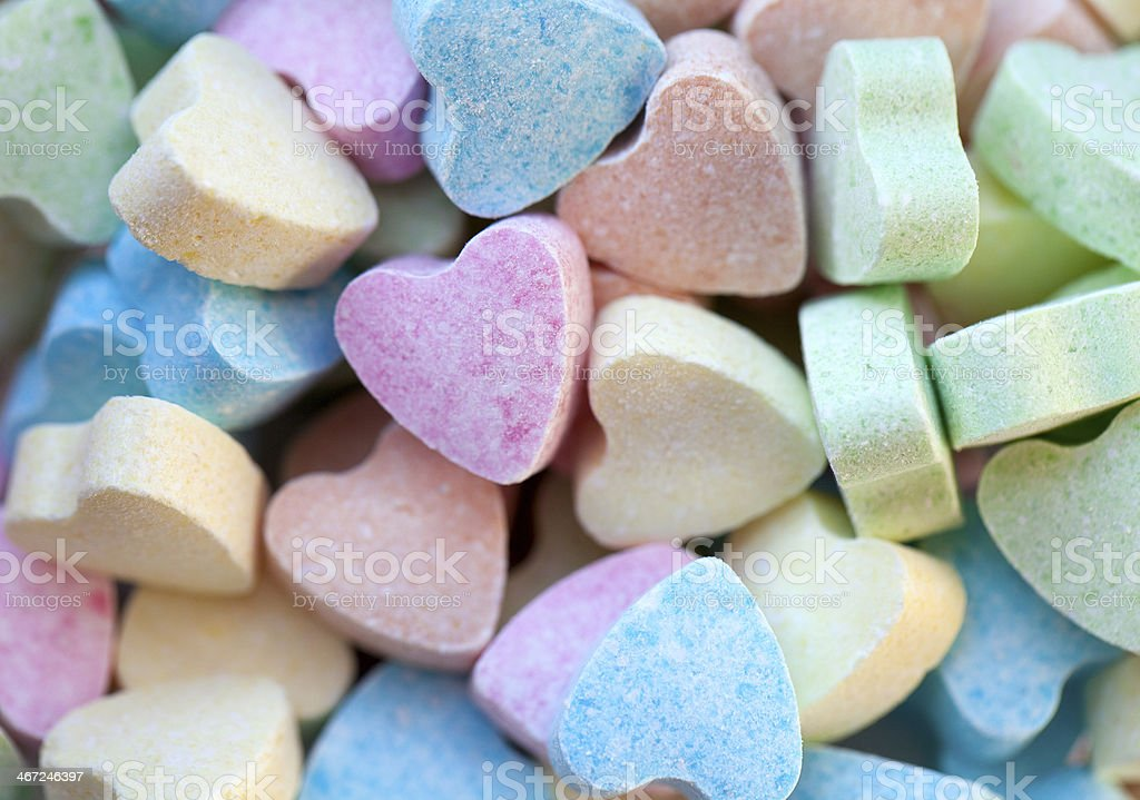 heart-shaped candies stock photo