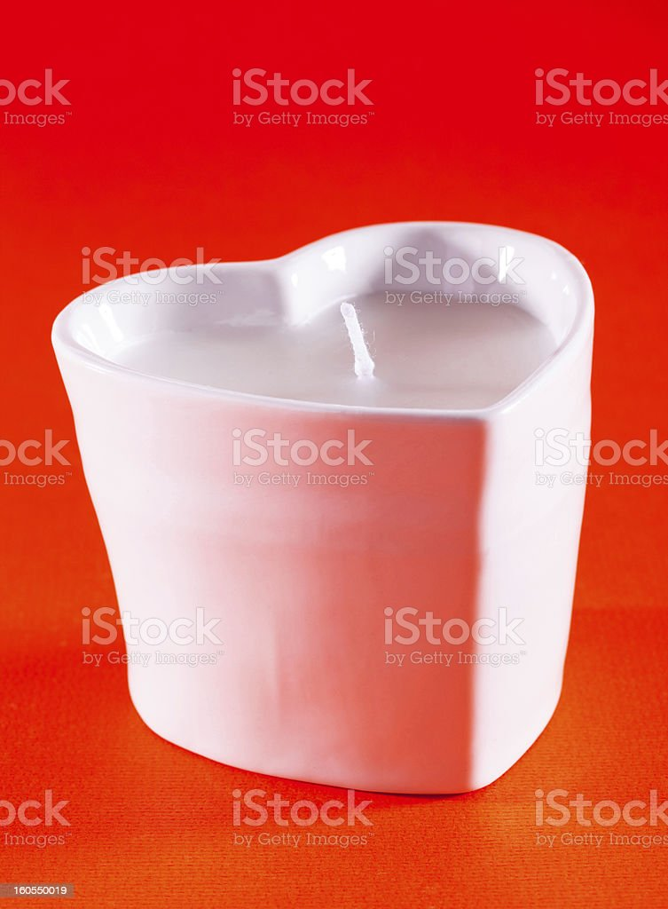 Heart-shaped candle royalty-free stock photo