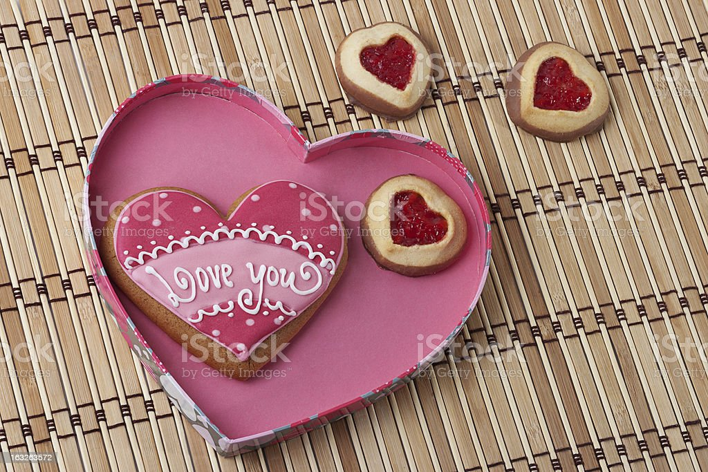 Heart-Shaped Cookies in a Pink Box on an wooden pad. royalty-free stock photo