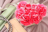 Heart-shaped flower arrangement of Carnation and jewelry gift