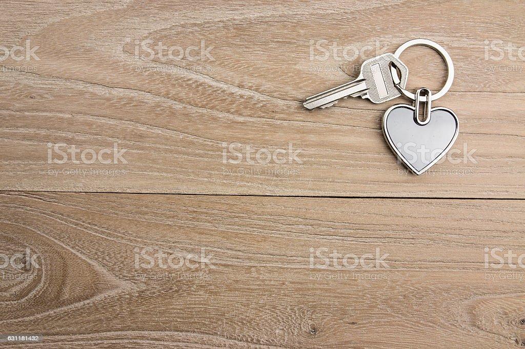 Heart-shaped keys in the wood stock photo