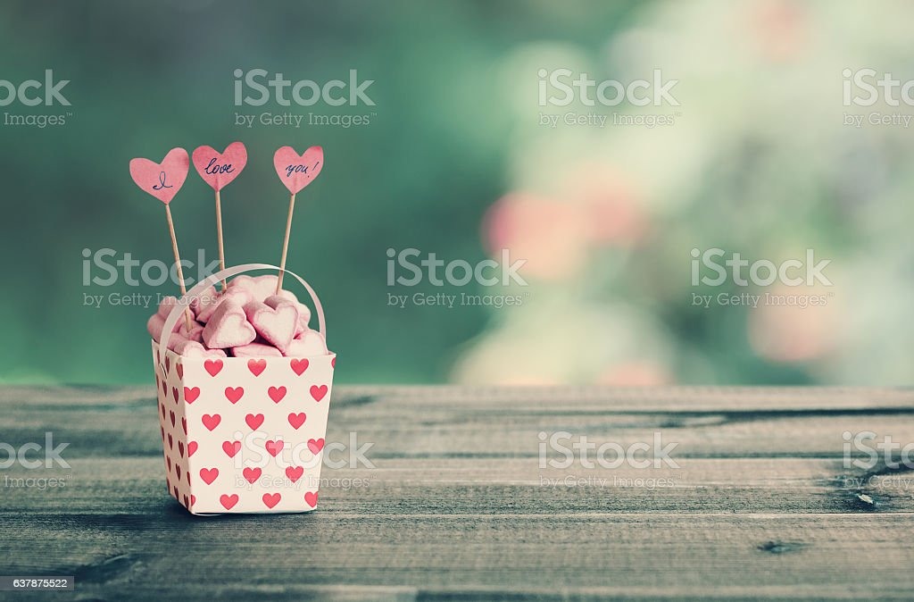 Heart-shaped marshmallows in the paper bucket stock photo